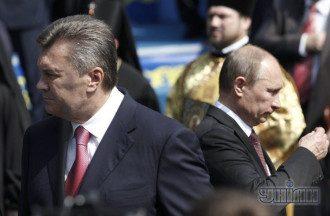 Виктор Янукович и Владимир Путин во время молебна в Киеве