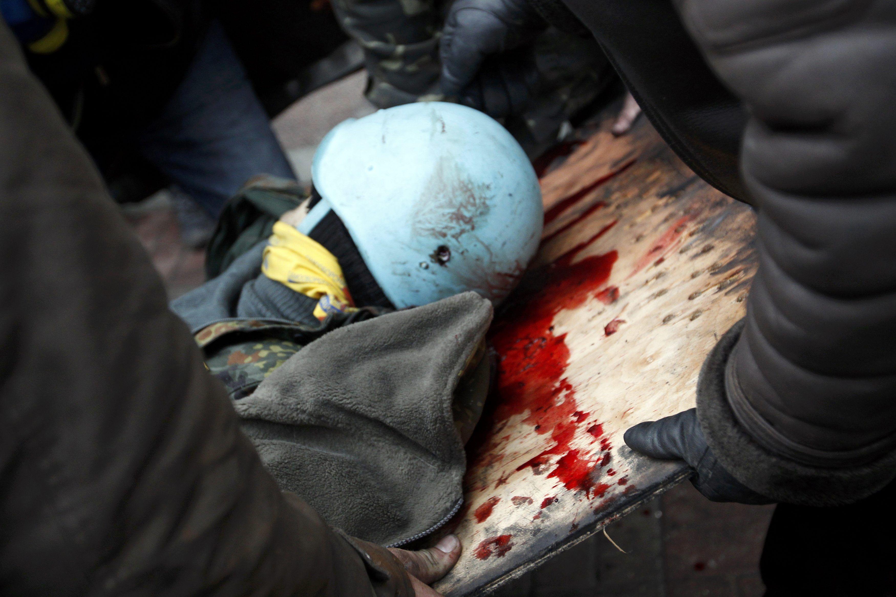 Активист с простреленной каской