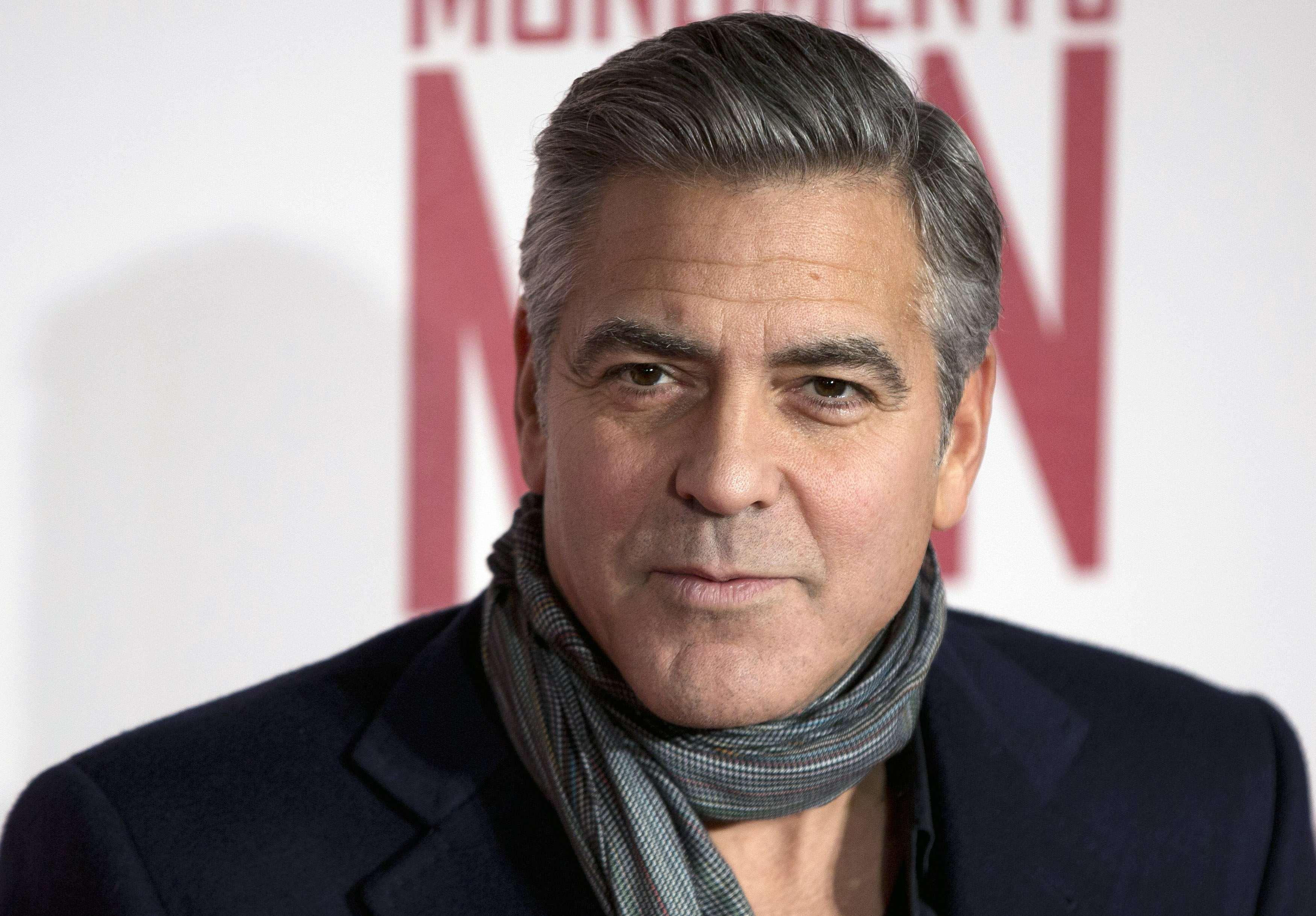 Клуни отблагодарил друзей чемоданчиками с деньгами