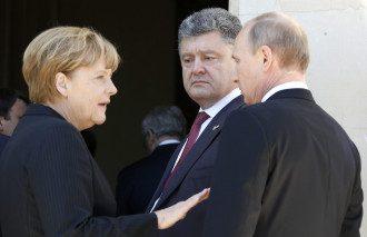 Порошенко, Путин и Меркель во время встречи в Нормандии