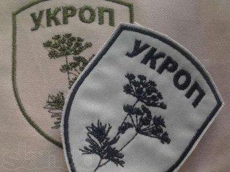 В Горловке россияне надевают шевроны
