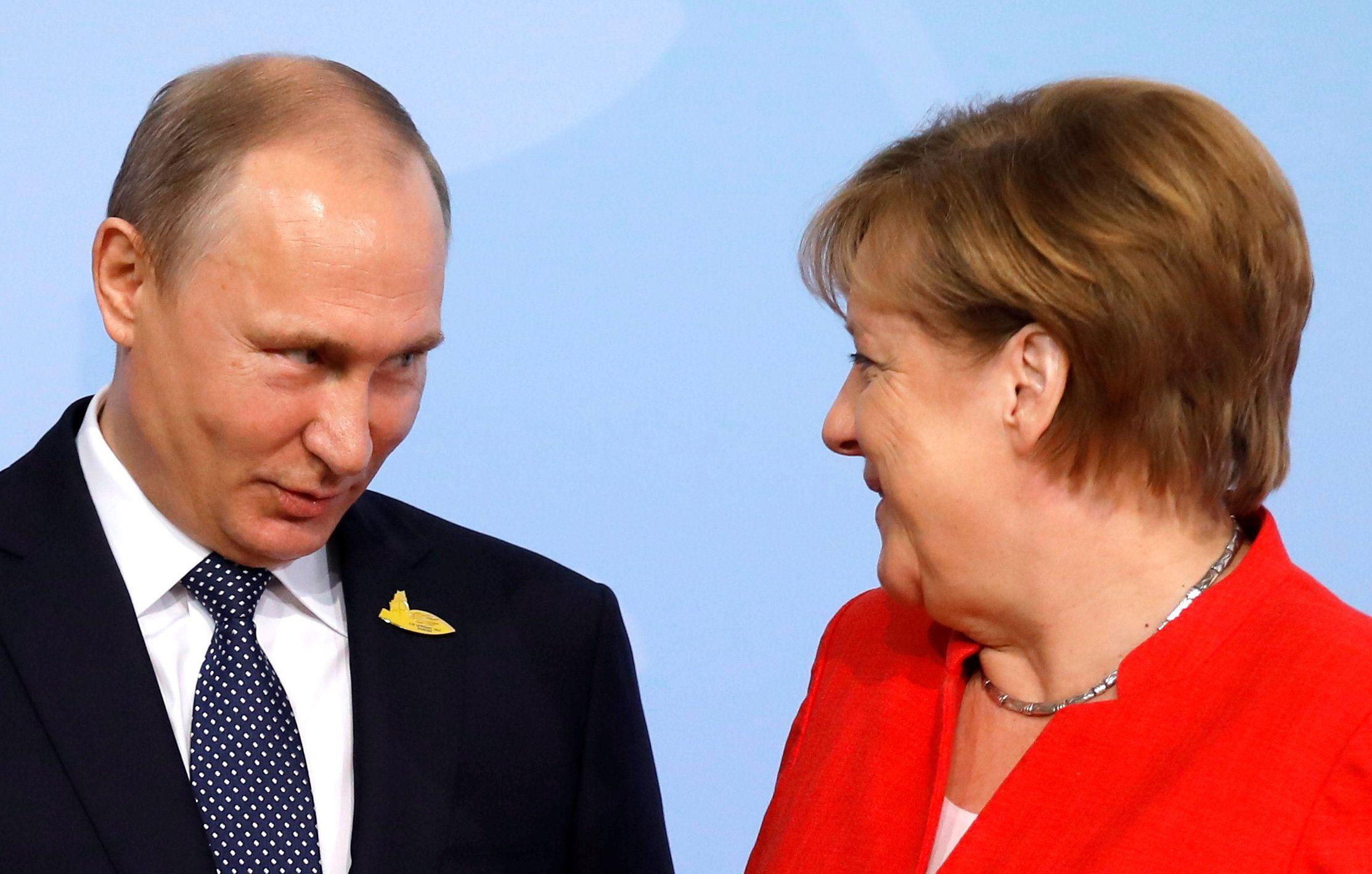 Ангела Меркель, Влаlимир Путин.
