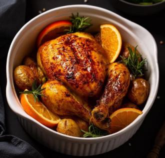 Курица с апельсинами готовится в духовке, разогретой до 200 градусов - курица в духовке