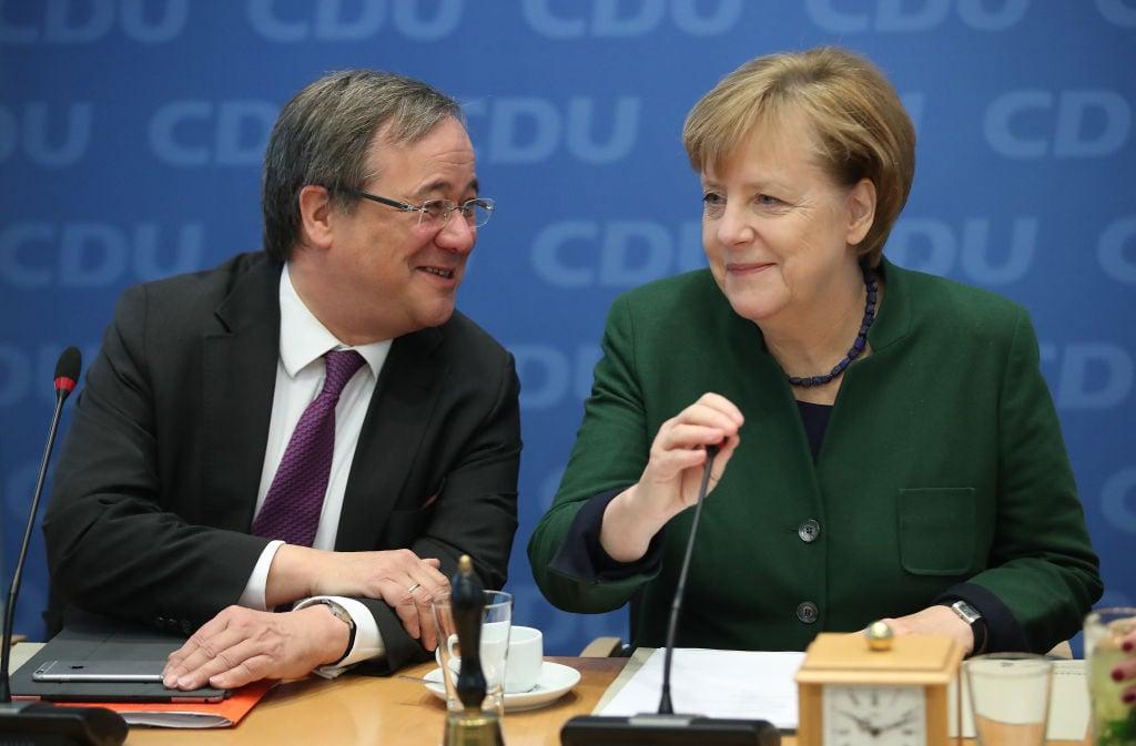Армін Лашет і Ангела Меркель