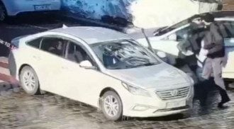 Стало известно, кто погиб от кулака дерзкого водителя в центре Киева / скриншот из видео